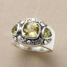 """CITRONEE RING--Flanked by two trillion-cut peridots, an impressive checkerboard-cut lemon quartz stone sits in splendor upon a handcast sterling silver band. Imported. Catalog exclusive. Whole sizes 5 to 9. Tapers 3/8"""" to 1/4""""W."""