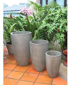 @Overstock.com - Enhance your patio decor with these graduated pots  Garden accents are available in grey color option  Large pot measures 19.7 inches in diameter x 31.5 inches highhttp://www.overstock.com/Home-Garden/Graduated-Tall-Planters-in-Grey-Set-of-3/2434547/product.html?CID=214117 $199.00