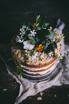 cake ideas + edible flowers + strawberries, blueberries, etc.  On cake table be sure to have serving utensils, two plates and flowers.