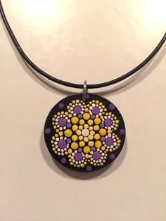 "This is a painted wooden pendant measuring 3.5cm (Just over one inch) in diameter. It is lightweight and strung on very comfortable leather cord. It is adjustable from 16"" to 19"". The chain, clasps, and fixtures are all stainless steel. This pendant is hand painted by me using acrylic"