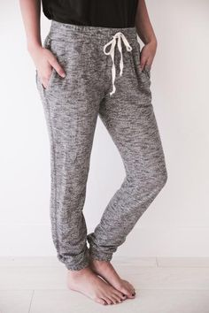 """• Speckled dark grey jogger sweats with pocket • Available in sizes S, M, L.Aspyn is 5' 4"""" and wearing a size small • 95% COTTON, 5% SPANDEX"""