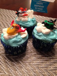 Disney Planes birthday party cupcakes...such a huge hit with my toddler boy! I made clouds from white chocolate melting candy and marshmallow. Cupcake toppers were from the Disney Planes micro racers line.