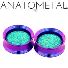 """1"""" Floating Stone Eyelets in ASTM F-136 titanium, anodized blurple; synthetic opal #11 (lime green) gems"""