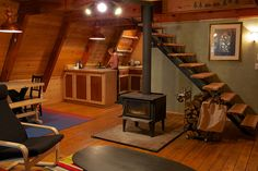 wood burning stove, kitchen open to livingspace, wood, slanted ceiling...