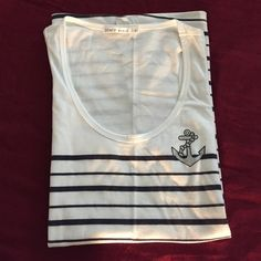"""Comfy cute tank top Black and white stripes with a sparkly anchor pattern motif. Barely worn, no stains, rips or tears. Measurements going around are: chest 34"""", waist 38"""", hips 46"""", length including straps 27"""". Tops Tank Tops"""