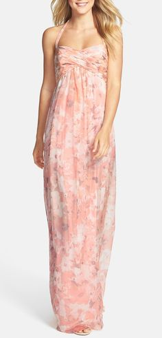 This floral Amsale maxi is the perfect bridesmaid dress for a beach or garden wedding. Pretty halter neckline and flowy chiffon fabric. Even works great for larger busts!