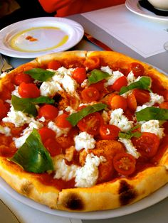 pizza with buffalo mozzarella tomatoes basil and ricotta stuffed crust golden view