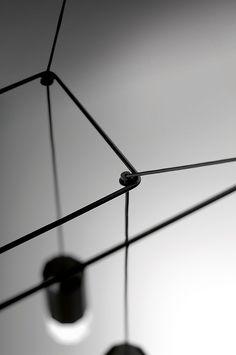 6 Boundary-Pushing Wire Form Furnishings | Wireflow light from Vibia. #design #interiordesign #interiordesignmagazine #lighting @vibialight