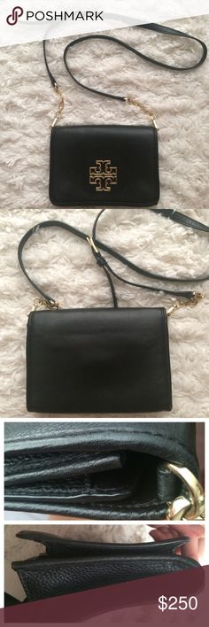 Tory Burch Crossbody Beautiful bag. this is new, it was a floor model. Minor wear in the corner (see photo). No dust bag. Straps can be detached and worn as a clutch! Inside has a two zip compartments and two slots for cash Tory Burch Bags Crossbody Bags