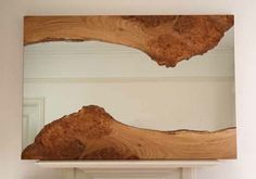 These beautiful mirrors are created by British artist Caryn Moberly from pieces of burred elm. The design mirrors that of a river, flowing and irregular. Every mirror is unique, filled with knots, burls and signed by the artist.