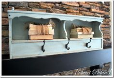 good idea... using a headboard as a shelf with hangers...