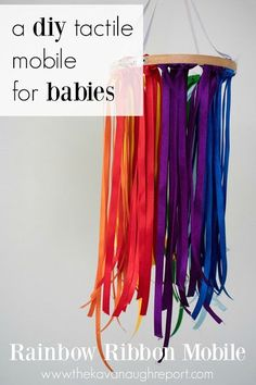 A DIY tactile mobile for babies. This easy rainbow ribbon mobile can be made in 20 minutes and keep babies entertained and engaged! #infantsplay