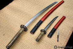 Katana of traditional hon san mai construction of 27 and a half inch nagasa with bohi. With a itame hada, gunome midare hamon, chu-kissaki. Silver habaki. Ko-wakizaski of hirazukuri style, bohi, itame hada, gunome midare hamon, silver habaki. Koshirae of both swords done in Higo style with pierced and carved iron tsuba, shibuichi fuchikashira and gold dragonfly menuki. Wakazashi has an umabari with slot inleted into saya. by Michael Bell. #dragonflyforge #sword #dagger #martialarts #art…