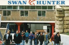 Workers pour out of Swan Hunter Shipyard in Wallsend