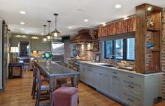 Another awesome kitchen with great textures! transitional kitchen by K & K Custom Cabinets LLC