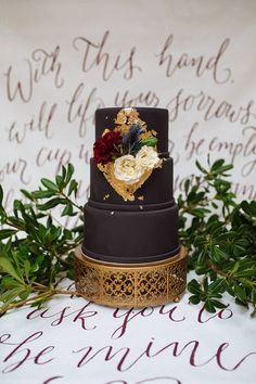 dark wedding cake with gold foil - photo by Smith House Photography http://ruffledblog.com/black-tie-halloween-wedding-inspiration #weddingcake #cakes