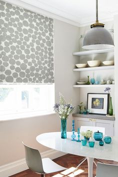Grey is a perfect way to lift an interior while keeping the decor neutral. Patterns and plains create a great contrast add glass accessories in different colours to bring a bit of fun into the room. Our Olli Rubble Roman blind is perfect for this look.