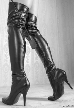 I've been given to wondering what happened in my early years to make me find boots like these amazing and sexy?