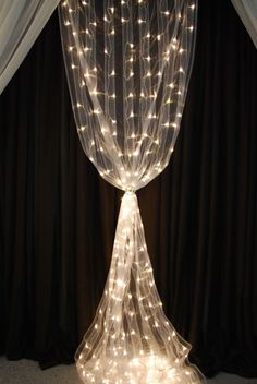 This soft white organza curtain is sprinkled with 200 warm white LED lights.  The curtain measures 48 inches wide and is 8 feet long. Rods not included.  It is powered by AC.