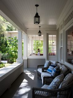 Love the glass room off to the side + the cozy porch!