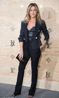 Jennifer Aniston cosies up to Justin Theroux at Louis Vuitton in Paris #dailymail