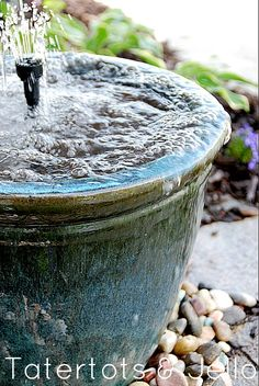 recirculating water fountain, do it yourself    http://tatertotsandjello.com/2012/05/spruce-up-your-outdoor-space-with-a-diy-recirculating-fountain-tutorial-and-100-lowes-giveaway.html#