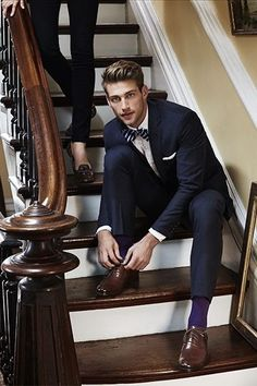 Navy suit, striped bow tie, colored socks, brown shows, & white pocket square