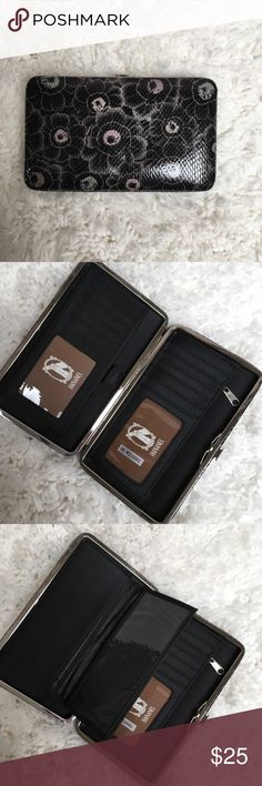 """3️⃣H A N A N E L  WALLET H A N A N E L  WALLET  Perfect wallet for the gal on the go!  Colorful, compact and convenient. Sturdy metal frame with easy-open clasp. Multi-function interior accommodates ID photo window, credit card slots, cash, checkbook holder!    ⚜️Measurements are 7.5"""" length x 1"""" width x 4.5"""" height ⚜️Sleek, unique & chic wallet ⚜️Opens easily & lies flat to allow easy access ⚜️Zippered pouch ⚜️Pocket on the back of wallet ⚜️Bonus checkbook cover included Bags Wallets"""