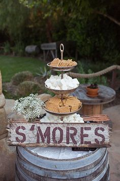 A backyard wedding really isn't complete without a s'more station, especially if you're throwing a bonfire at the end of the night. Display the goodies on a distressed barrel to complete the rustic look.