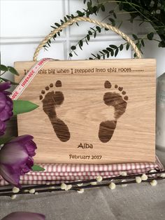 Footprints engraved in solid oak wood with rope hanging detail