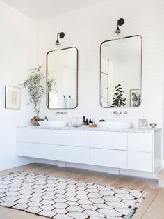 Custom mirrors and vintage lights hang above the vanity in the master bathroom.