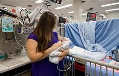 Jennifer Tano holds her son Thomas in the neonatal intensive care unit of Mount Sinai Hospital in Toronto on Wednesday, Sept. 11, 2013.