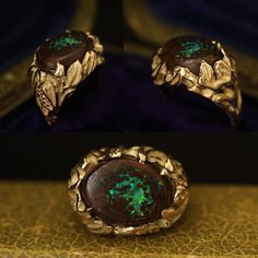 This bizarre piece of midcentury studio jewelry features a boulder opal within a wild, asymmetrical setting. The shoulders have a Bacchanalian theme: one side is adorned with a bunch of grapes and the other with a climbing nude female figure.    Materials: 14k yellow gold, boulder opal  Age: c. 1960  Condition: Excellent  Size: US 5, can be resized for an additional fee of $90  Location: To see this ring in person please visit our shop in Boerum Hill, Brooklyn. ...