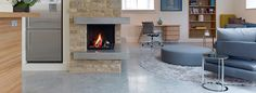 Light Natural Lazenby Polsihed Concrete with a pre-cast hearth to match.
