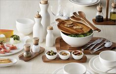 """""""This collection is designed for casual tapas style entertaining, which is my favourite way to dine with friends. I love how the acacia wood accents warm up the pure white ceramics."""" — H&H editor Margot Austin 