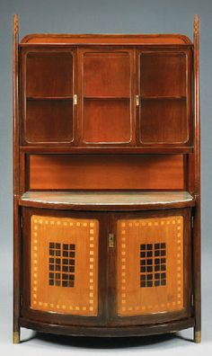 A BENTWOOD AND CHECKERBOARD PATTERNED CABINET  Koloman Moser, after, J. & J. Kohn, circa 1902,  87in. (222.9cm.) high, 50in. (127cm.) wide, 25in. (63.5cm.) deep |  SOLD $27,600 Christie's New York, June 11, 1999
