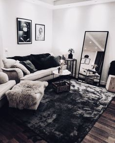 This living space has heavy contrast in both texture and tone. There is contrast in tone between the dark flooring and the light couch, walls, and ceiling. The contrast in texture comes primarily from the large rug against the grain in the wood flooring. Shag Rug, Couples, Couch, Rugs, Ideas, Home Decor Bedroom, Diy Home Decor, Furniture, Shaggy Rug