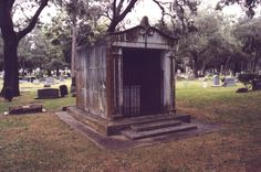 Old, Creepy Mausoleum with Iron Gate