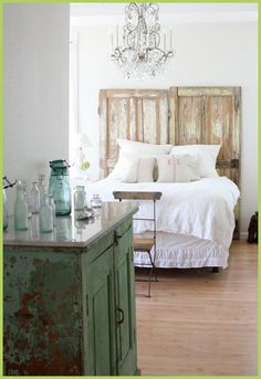 I love the idea of using old doors for a headboard.