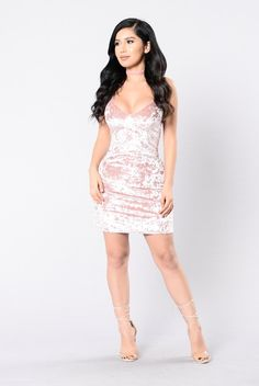 "- Available in Pink - Crushed Velvet Shift Dress - Loose Fit - ""V"" Neck - Non Adjustable Straps - Mini Length - Made in U.S.A - 96% Polyester 4% Spandex"