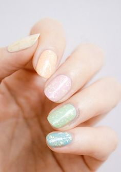 So Nailicious always knows the perfect way to keep festive looks chic on your fingertips, and these gold-flecked Easter eggs are a great example. #Spring #NailArt