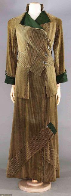 "VELVET WALKING SUIT, JENNY, PARIS, 1917  Beige & black pin striped velvet, dark green wool collar, lapels & cuffs, diagonal piecing to jacket, label ""Jenny & Cie Paris"""