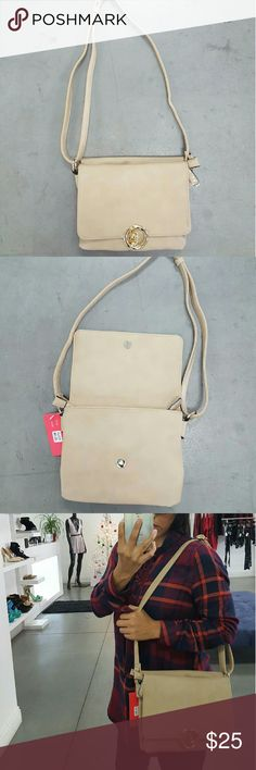 Beige Cross body bag Supe cute bag with double flaps, super roomy. Smooth texture PU leather, adjustable long strap, magnetic closure with flap, front and back zipper pockets middle open Pocket. 9.5 w ? 3 d ? 8 h inch. Bags Crossbody Bags
