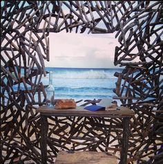 "INSTAGRAM 22 Aug. Laura Chatz (photo). Artwork 'Genius Loci' by Andrea Cristoforetti and Roger Trebilcock ""the driftwood man"". Site_Specific #LandArtBiennale. #LandArt #Plett"