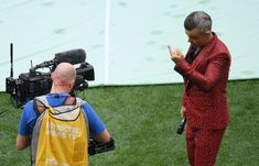 Image contains profanity.) Singer Robbie Williams gestures into a TV camera during the opening ceremony prior to the 2018 FIFA World Cup Russia Group A match between Russia and Saudi Arabia at Luzhniki Stadium on June 2018 in Moscow, Russia. World Cup 2018, Fifa World Cup, Robbie Williams, Opening Ceremony, Saudi Arabia, Singer, Moscow Russia, June, Group