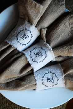 Monogram burlap or linen napkin rings. Full link: http://cfabbridesigns.com/craft-projects/psa-essentials-product-giveaway-enter-for-a-chance-to-win-a-custom-stamp/#.UtILnNJdWHg
