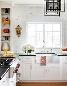 Powers | Gray Walker Interiors #interiordesign #homedecor #kitchen #whitekitchen #marble #blackcounters #kitchendecor