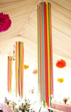.Crepe paper hung from embroidery hoops like chandaliers