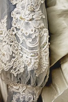 Beautiful lace & pearl detail~❥Would love to have a long sleeved tunic out of this lace and pair it with black velvet leggings!