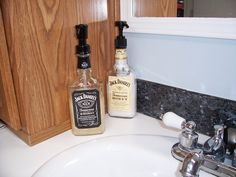 Saw this...I used black label for the soap and Honey JD for the lotion. They look off balanced because the dispenser pump is taller than I like but they look great in our Cowboy Bathroom